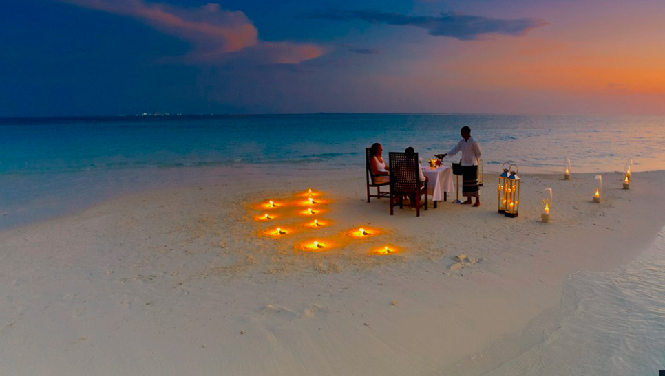 Sunset dining by lamplight